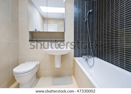 Bathroom detail with toilet, sink and bath tub