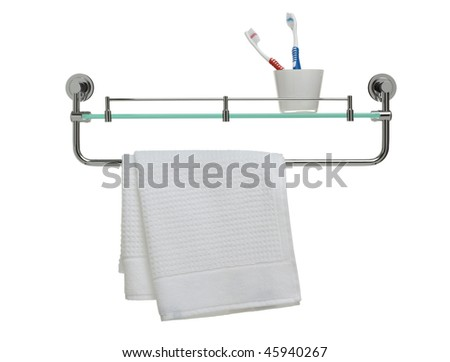 bathroom display with glass, toothbrushes and fresh towel hanging from rail - stock photo