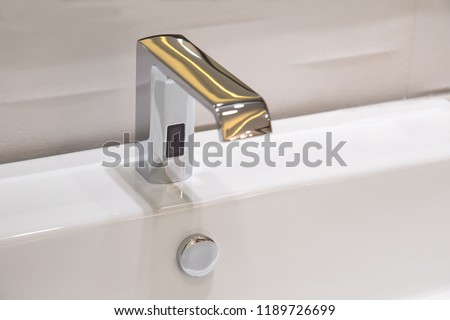 Bathroom faucet in polished chrome powered automatic by sensor. object about home Improvement. #1189726699