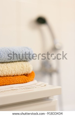 Bathroom interior: closeup of towels folded up on a bathroom cabinet