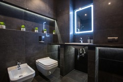 bathroom interior in a modern style, dark color, real apartment