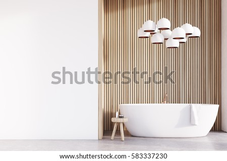 Bathroom interior with a tub, a chair with body care products, a light wooden wall and a lamp resembling grapes hanging above it. White wall fragment. 3d rendering.  Mock up.