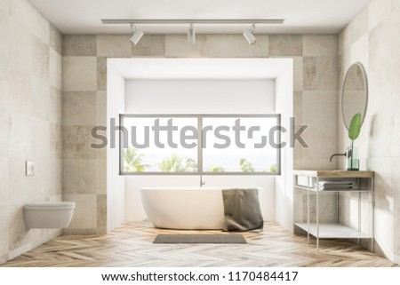 Bathroom interior with beige tile walls, a wooden floor, a bathtub under a large window, a sink and a toilet. 3d rendering