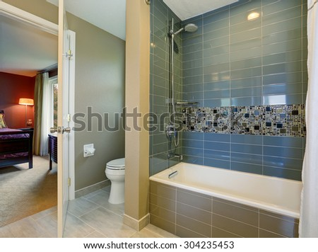 Bathroom interior with green walls, and tile floor.