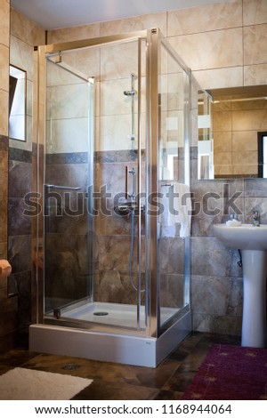 bathroom interior with shover #1168944064
