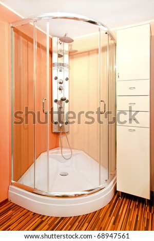 Bathroom interior with shower cabin and hydro jets