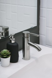 Bathroom interior with sink and faucet.