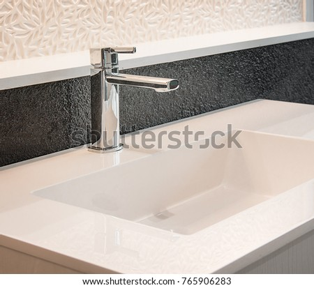 Bathroom interior with sink and faucet. #765906283