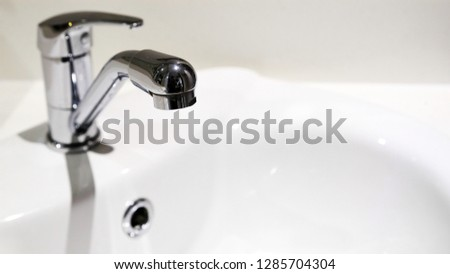 Bathroom interior with sink and faucet, Sink faucet. #1285704304