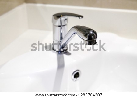 Bathroom interior with sink and faucet, Sink faucet. #1285704307