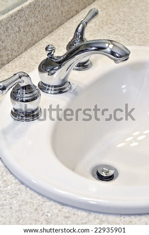 Bathroom interior with white sink and faucet
