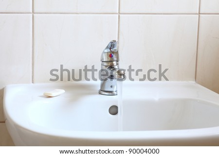 Bathroom interior with white sink and faucet - mixer tap
