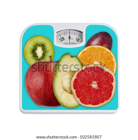 bathroom scale and fruits isolated on white background