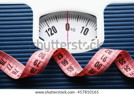 Bathroom scale with measuring tape on white background. Weight loss concept