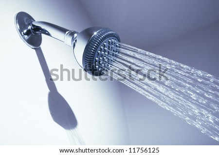 Bathroom shower head on blue background
