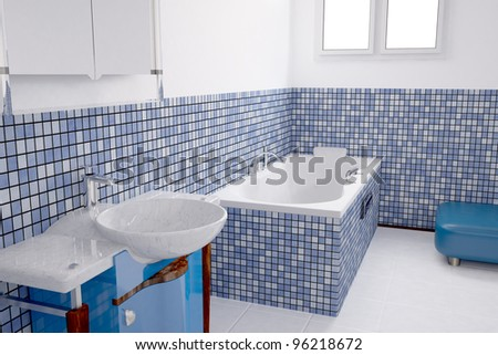 Bathroom with blue tiles and a basin
