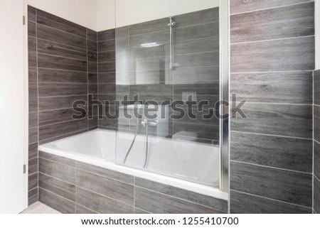 Bathroom with elegant minimalist brown tiles. Nobody inside