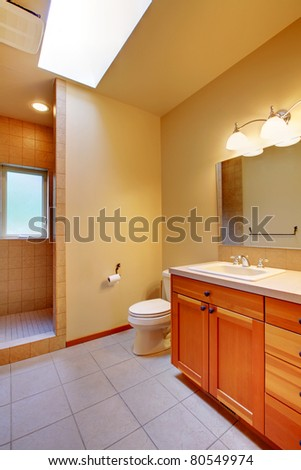 Bathroom with green walls and cherry cabinet