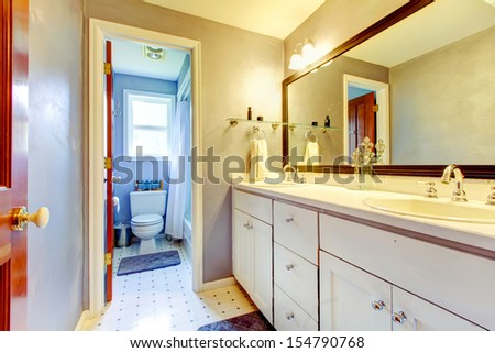 Bathroom with white cabinet and toilet area.