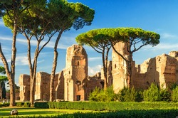 Baths of Caracalla, ancient Roman public baths, Rome, Italy. Scenic view of Baths of Caracalla ruins in sunlight. Nice sunny panorama of Roma landmark. Scenery of remains of antique culture in summer.