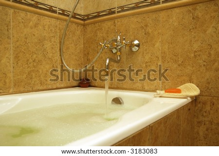 bathtub with pouring water