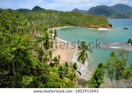 Batibou beach, northern Dominica, is considered to be the most beautiful beach on the island. This peaceful, sandy beach, surrounded by tropical forest, is being washed by mild waves of Caribbean sea. Stockfoto ©