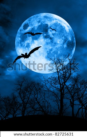 bats against full moon and tree silhouette, horror night concept
