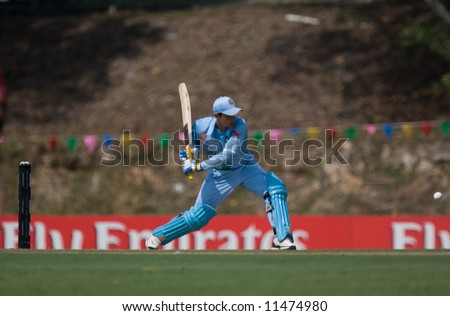 Batsman hitting cricket ball at tournament - stock photo