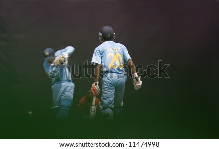 Batsman hitting cricket ball at tournament