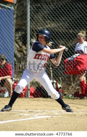Batter up, left-handed batter Softball player woman