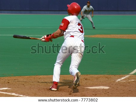 Batter watching his hit, baseball player on astroturf
