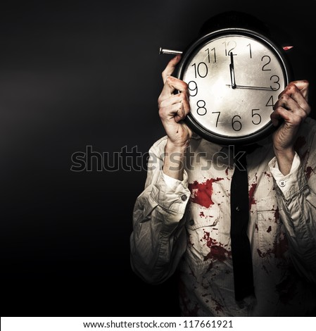 Battered And Blood Stained Business Man Hiding Behind A Clock Face In Countdown Concept Of A Time Deadline