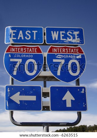 Battered Colorado Interstate 70 Signs pointing East and West