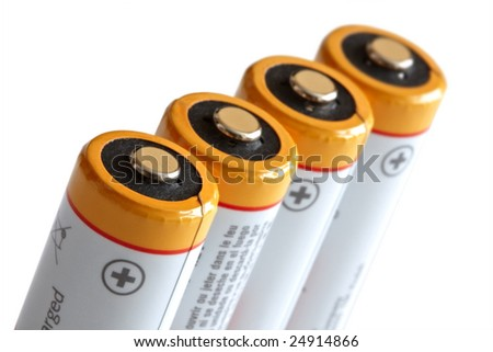 Batteries in a row. Isolated on white. Shallow DOF. Focus on a first battery.