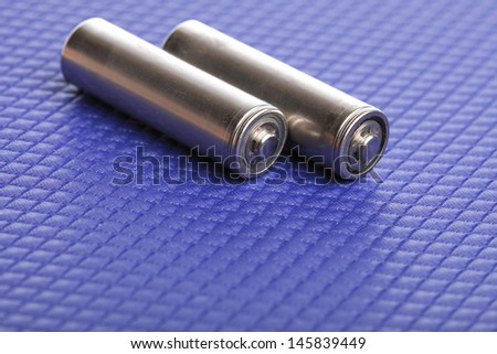 battery Energy supply equipment on blue background