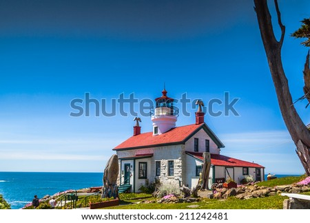 Battery Point lighthouse in Crescent City, CA. Under blue sky and low tide you can pass to the lighthouse