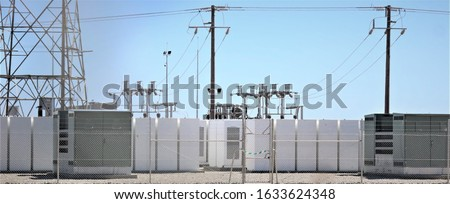 Battery storage at a Solar Farm with switchgear or switch gear in the background Stock photo ©