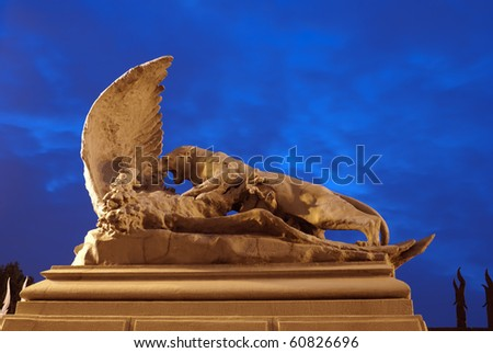 Battle of lioness and eagle. Statute near House with Chimeras in Kiev.