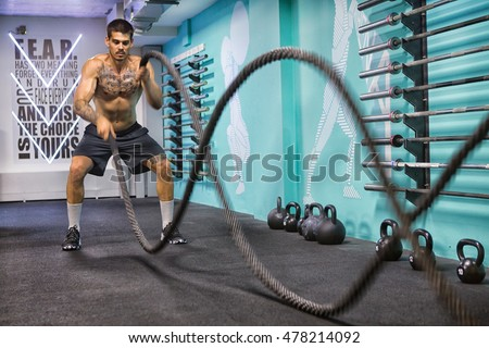 Battle ropes exercise in the gym
