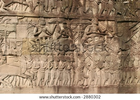 Battle scene on Angkor Wat wall. - stock photo