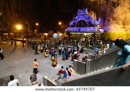 BATU CAVES, MALAYSIA - JANUARY 19:A crowd gathering around a temple during the Hindu festival of Thaipusam on January 19, 2011 in Batu Caves, Malaysia.