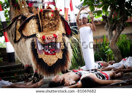 BATUBULAN, BALI, INDONESIA- JUNE 23: Unidentified men dance for tourists at the weekly  Barong Dance, the traditional balinese performance on June 23, 2011 in Batubulan, Bali, Indonesia.
