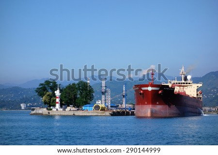 BATUMI, GEORGIA - JULY 7, 2014: A large size oil tanker loading crude oil in the Batumi oil terminal on a cloudless sunny day in July 2014.