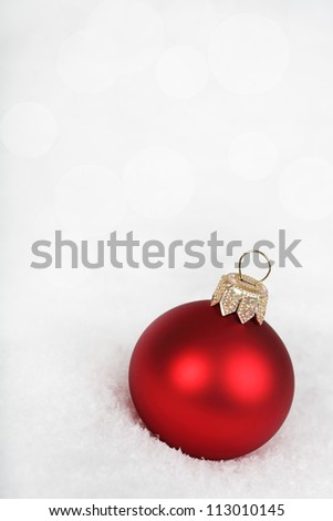 Bauble on the snow. - stock photo