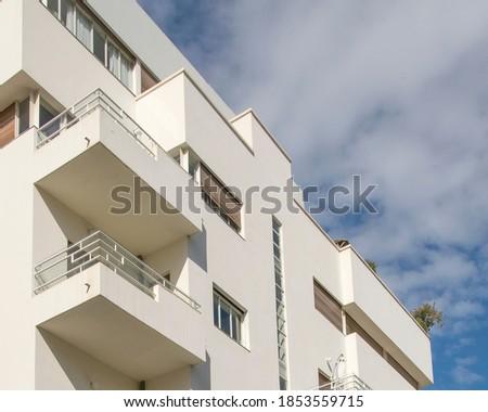 Photo of  Bauhaus style apartment building exterior view, tel aviv, israel
