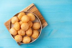 Baursak - traditional Kazakh (Asia) food \ national bread in plate on blue wooden background, top view