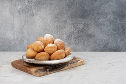 Baursak - traditional Kazakh (Asia) food \ national bread in plate on marble  background
