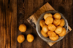 Baursak - traditional Kazakh (Asia) food \ national bread in plate on wooden background, top view