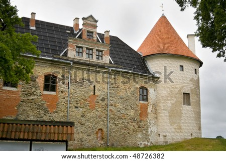 stock-photo-bauska-castle-is-a-complex-consisting-of-the-ruins-of-an-earlier-castle-and-a-later-palace-on-the-48726382.jpg