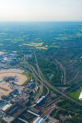 Bautiful view of the Gatwick airport and England from above with highways and forests.